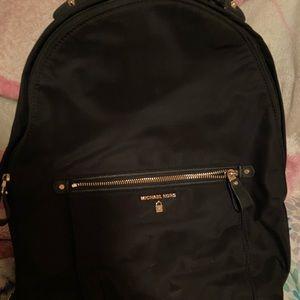 black michael kors backpack